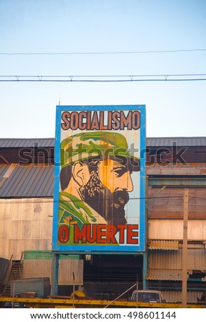 HAVANA, CUBA - FEB 6, 2011: Old factory in Havana with comunist propaganda featuring the image of Fidel Castro, cuban president until 2008.