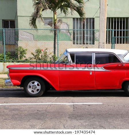 HAVANA, CUBA - FEBRUARY 24, 2011: Classic American car in the street in Havana, Cuba. Cuba has one of the lowest car-per-capita rates (38 per 1000 people in 2008). - stock photo
