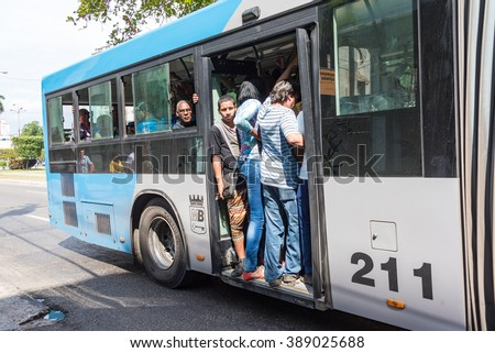 HAVANA,CUBA-FEBRUARY 8,2016: Cuban news public transportation: crowded bus unsafe practice.The omnibus in calle G or Avenue of the Presidents is so full that doors can not be closed. - stock photo