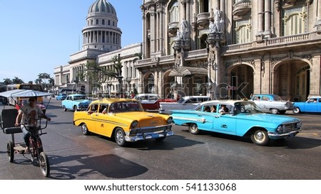 HAVANA, CUBA - FEBRUARY 27, 2011: People drive in Havana, Cuba. Cuba has one of the lowest car-per-capita rates (38 per 1000 people in 2008).
