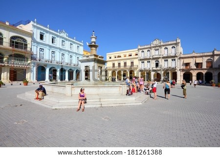 HAVANA, CUBA - FEBRUARY 27, 2011: People visit the Old Town Square (Plaza Vieja) in Havana, Cuba. Havana is the largest city in Cuba and its Old Town is a UNESCO World Heritage Site. - stock photo