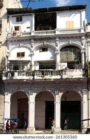HAVANA, CUBA - JANUARY 30:  Cuban people around a typical colonial house in Paseo del Prado on January 30, 2015 in Havana.  Daily life in old the city  - stock photo