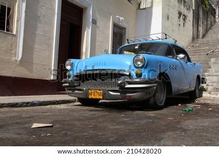 HAVANA, CUBA - JANUARY 30, 2011: Old classic Buick parked in Havana, Cuba. Cuba has one of the lowest car-per-capita rates (38 per 1000 people in 2008). - stock photo