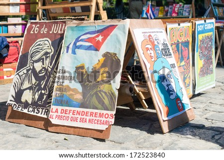 HAVANA,CUBA - JANUARY 20, 2014: Posters with revolutionary slogans for sale at a street market - stock photo
