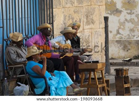 HAVANA, CUBA - JANUARY 30, 2011: Street musicians in Plaza de la Catedral San Cristobal, in Old Havana built between 1748 and 1777. - stock photo