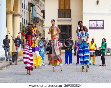 HAVANA,CUBA- JANUARY 24,2016 : Street performers dancing on stilts on a beautiful Old Havana square - stock photo