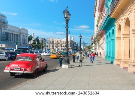HAVANA, CUBA - JANUARY 8, 2015 : Street scene with people and traffic on a beautiful sunny day in Old Havana - stock photo