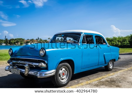 HAVANA, CUBA - JULY 03, 2015: Blue american vintage car under blue sky in Havana Cuba - HDR