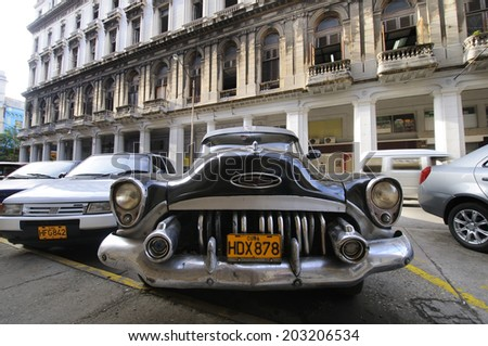 HAVANA, CUBA - JULY 9, 2010. Front view of vintage classic American car, commonly used as private taxi parked in Havana street.  - stock photo