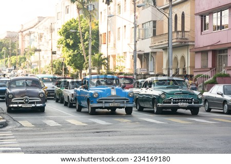 HAVANA,CUBA-JULY 3,2014: Old American cars in working condition. The scarcity in the cars supply has turned Cuba in rolling museum. Nowadays, many use those oldtimers to make an income. - stock photo