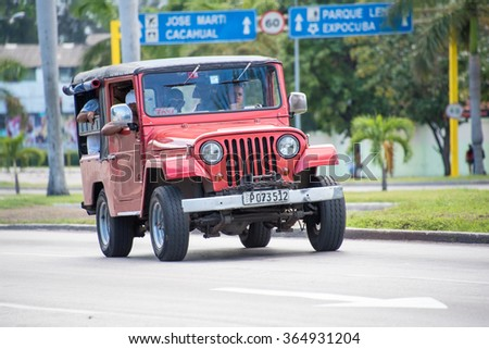HAVANA,CUBA-JULY 4,2015: Old vintage cars in moving action Havana,Cuba.  The old vintage cars in Cuba are both a major tourist attraction and a danger to passengers due to poor technical conditions..