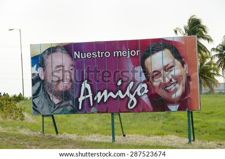 "HAVANA, CUBA - June 10, 2015: Billboard depicting Fidel Castro & Hugo Chavez. The sentence says ""our best friend"". - stock photo"