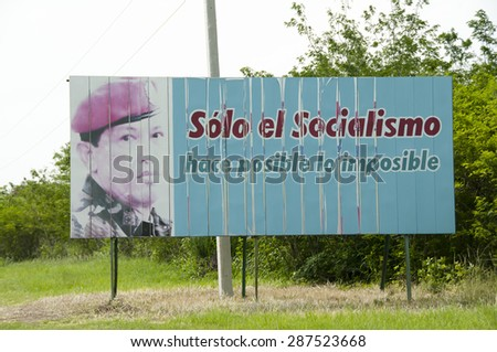 "HAVANA, CUBA - June 10, 2015: Billboard depicting Hugo Chavez in his military uniform with the slogan ""only socialism makes possible the impossible"" - stock photo"