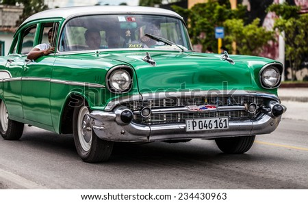 HAVANA,CUBA - JUNE 27, 2014: Green american classic car on the road in havana