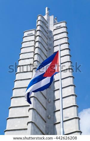 HAVANA,CUBA - JUNE 22,2016 : Monument and waving cuban flag at the Revolution Square in Havana - stock photo