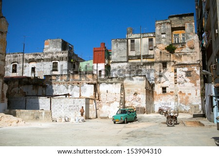 HAVANA,CUBA - JUNE 23: Old buildings in Havana, June 23, 2013, Havana, Cuba. Havana is one of the most beautiful cities in Latin America, but all the buildings in the city are in a terrible state. - stock photo