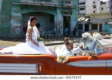 HAVANA, CUBA - MARCH 16: A girl being driven around town during her Quinceanera party on March 16th 2009 in Havana, Cuba. Quinceanera is a traditional Cuban coming-of-age party for 15 year old girls