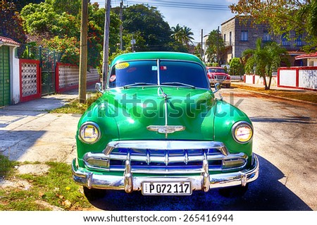 HAVANA, CUBA - MARCH 21, 2015 - Classic old car in Havana neighborhood. - stock photo