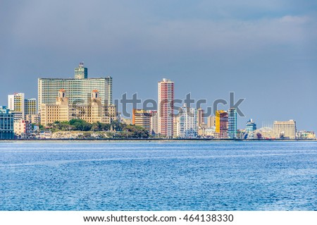 HAVANA, CUBA - MARCH 17, 2016: The skyline of the Vedado neighborhood with its skyscraper hotels on the shore in Havana, the capital of Cuba