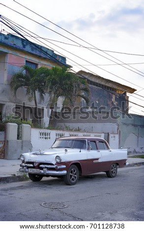 HAVANA, CUBA - MARCH 21, 2015 - vintage Dodge car with Packard hood ornament on city street in Havana, Cuba on March 21, 2015
