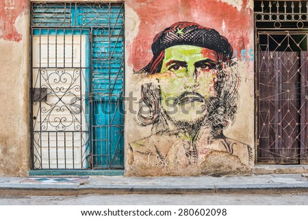 HAVANA,CUBA - MAY 20,2015 : Che Guevara portrait painted on a shabby old wall in Old Havana - stock photo