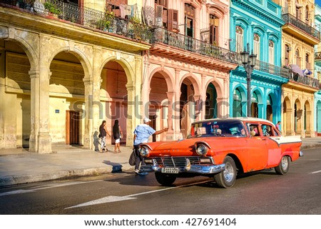 HAVANA,CUBA - MAY 26,2016 : Street scene with old car and colorful buildings in Old Havana - stock photo