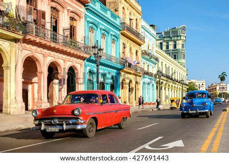 HAVANA,CUBA - MAY 26,2016 : Street scene with old cars and colorful buildings in Old Havana