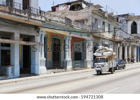 HAVANA, CUBA - MAY 5, 2014: Street scene with old van and worn out buildings. - stock photo