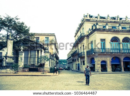 Havana, Cuba : 2012, November 28 : A man walking in front of the colonial Templete in Plaza de Armas in the historic center of Havana, Cuba
