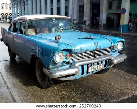 HAVANA, CUBA - NOVEMBER 23:  An american vintage blue car in the center of the town ,on november 23, 2014, in Havana, Cuba