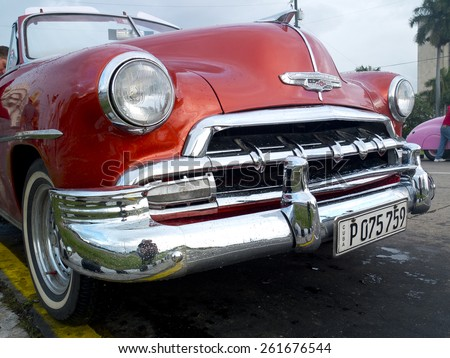 HAVANA, CUBA - NOVEMBER 21: beautiful bright body of a vintage red taxi, on november 21, 2014, in Havana, Cuba. - stock photo
