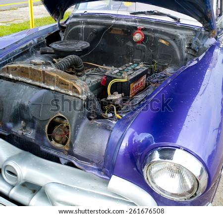 HAVANA, CUBA - NOVEMBER 21: original engine for this vintage american car, on november 21, 2014, in Havana, Cuba. - stock photo