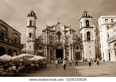 Havana, Cuba - 2012, November 29 : The baroque facade of the colonial Virgin Mary of the Immaculate Conception cathedral of Havana and its square with people