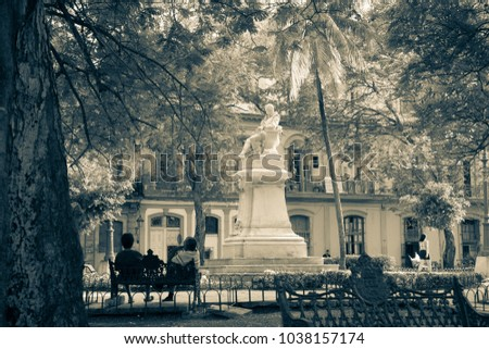 Havana, Cuba - 2012, November 29 : The park San Juan de Dios in Old Havana with the marble statue of Cervantes in the center