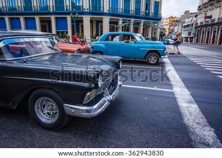 HAVANA, CUBA - OCTOBER 28-Old American restored cars fill the streets of Havana, Cuba on Oct 28, 2015_ - stock photo