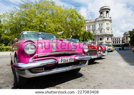 HAVANA, CUBA - OCTOBER 8, 2014: Old classic American car in street city Havana. Before a new law issued on October 2011, Cubans could only trade cars that were on the road before 1959. Wide angle. - stock photo