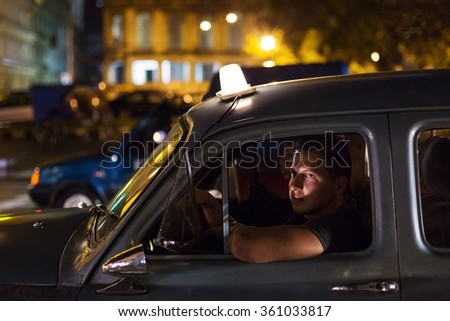 HAVANA,CUBA-OCTOBER 14:People and old car on streets of Havana October 14,2015 in Havana. With 2.4 mil. inhabitants in the city and 3.7 in its urban area, Havana is the largest city in the Caribbean