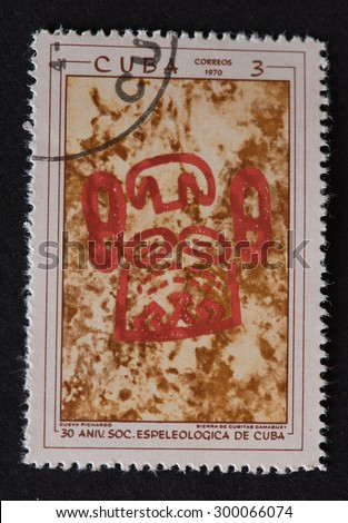 HAVANA,CUBA-REVOLUTIONARY PERIOD:Cuban postal stamp of 1970 showing red coloured petroglyphs in Cuban Cave commemorating the 30th Anniversary of the Speleological Society of Cuba.  - stock photo