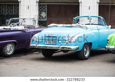 Havana, Cuba - September 22, 2015: Classic american car parked on street of Old Havana,Cuba. Classic American cars are typical landmark and atraction for whole Cuban island.