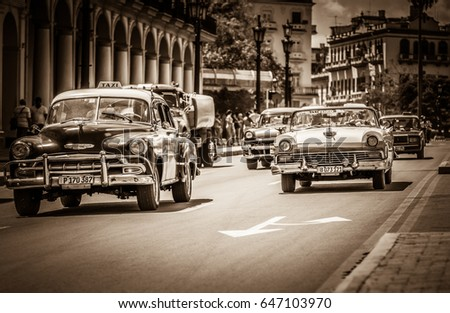 Havana, Cuba - September 14, 2016: HDR - American Chevrolet classic cars and a Ford Fairlane classic car with white roof drive  on the street in Havana Cuba - Retro SEPIA Serie Cuba Reportage