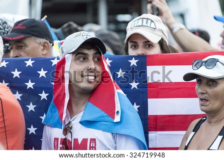 HAVANA,CUBA-SEPTEMBER 20,2015:Scenes of Pope Francis to Havana, specifically the historic Catholic Mass held in the Revolution Square. USA flags are more and more common in the Caribbean Island