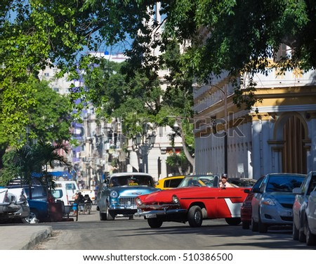 Havana, Cuba - September 14, 2016: Street life view with a american red Mercury Cabriolet classic car  in Havana Cuba - Serie Cuba 2016 Reportage