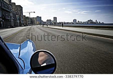 HAVANA,CUBA: Vintage american car at the Malecon avenue during a beautiful sunset - stock photo