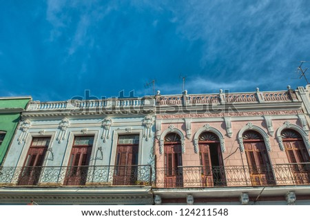 HAVANA-DECEMBER 26:Street scene with cuban colorful old buildings December 26,2012 in Havana.Founded in 1515,Havana is the largest city in the Caribbean with 2.4 million inhabitants - stock photo