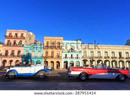 HAVANA - FEB 5: Classic Cars in  Old Havana main street, on February 5th, 2015 Havana, Cuba.Old cars and the UNESCO protected part of Old City are attracting millions of tourists every year - stock photo