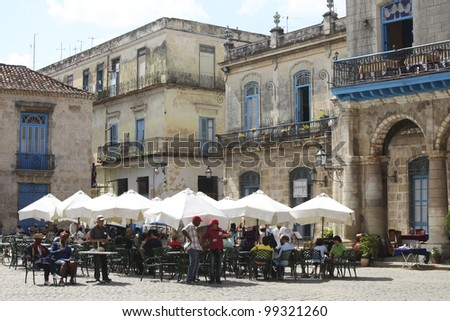 HAVANA-Feb 21:Tourists at a restaurant near the Havana Cathedral on Feb 21,2011 in Havana.Tourism has become one of the main source of income for the country with over 2 million visitors a year - stock photo