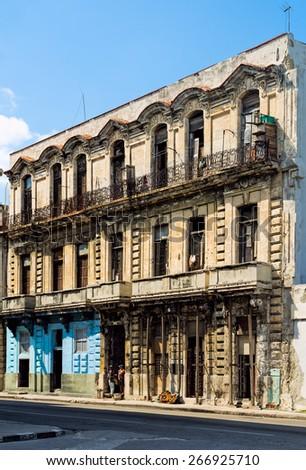 HAVANA - FEB 13: Two men standing in the doorway of an old building in Havana photographed on February 13, 2015. - stock photo