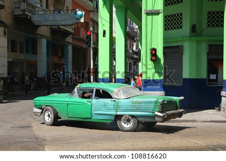 HAVANA - FEBRUARY 26: Classic American car on February 26, 2011 in Havana. Recent change in law allows the Cubans to trade cars again. Most cars in Cuba are very old because of the old law. - stock photo