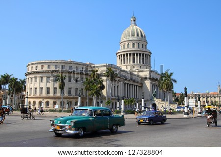 HAVANA - FEBRUARY 26: Cubans drive Classic American cars on February 26, 2011 in Havana, Cuba. Recent change in law allows the Cubans to trade cars after it was forbidden for many years. - stock photo