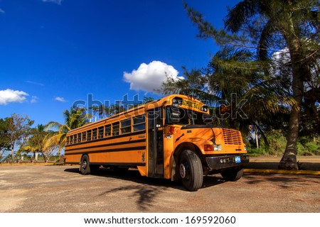 HAVANA - FEBRUARY 12: Old american school bus on the street on February 12, 2013 in Havana. Old american buses are still in good condition in Cuba as they are still in service. - stock photo